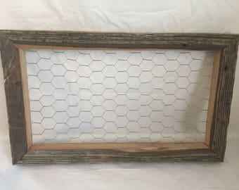 Rustic reclaimed wood picture hanger frame