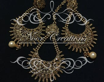 Gold Intricate Detailing with White Pearls Earrings with Matching Tikka