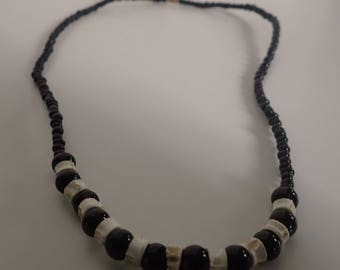 Necklace with beads & leg with screw cap