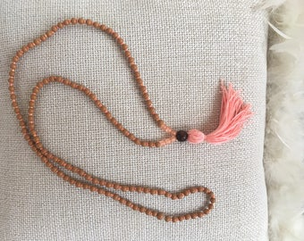Beautiful tassels chain in delicate shades of Orange and camel-
