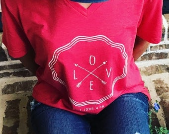 Love heathered red v-neck vintage-style tee with cream graphic