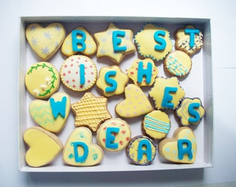 a box of cookies with a message on them, sweet gift
