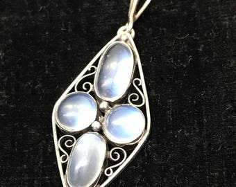 Antique Arts and Crafts moonstone sterling silver pendant from about 1910