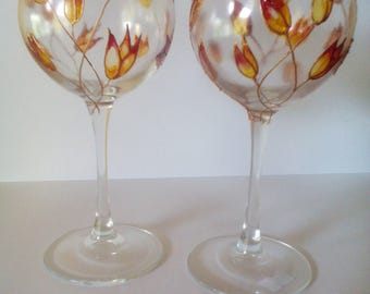 Set of 2 hand painted wine glasses.