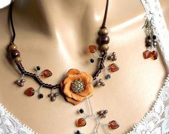 Topaz leaves and orange camelia flower set