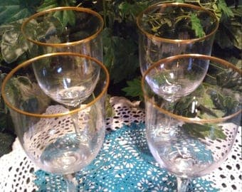 A set of 4 Noritake Crystal Wine Glasses Gold rim water goblets