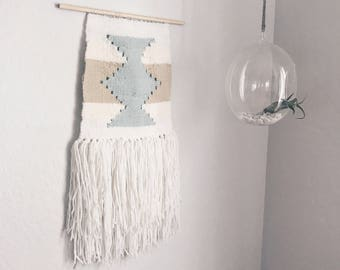 Neutral and blue southwest woven wall hanging