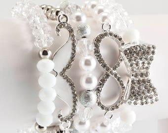White, silver, infinity, bow, 5 stack Glam bracelet
