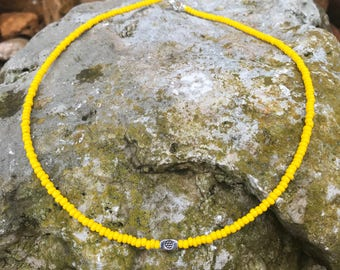 Silver Plated Flower Spacer on a Yellow Seedbead Necklace