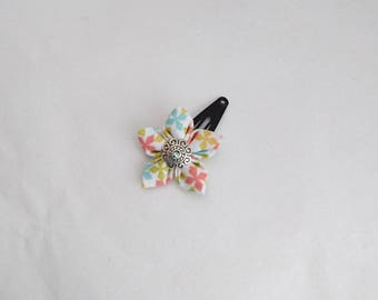 Flower hair clip in white, orange, green, blue, yellow colored fabric