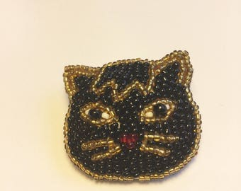 Beaded black and gold cat pin/brooch