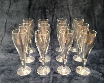 12 matching small champagne flutes - circa 1970s