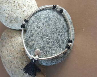 silver tube beads and tassel