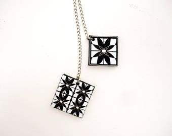 Long necklace pendants in leather, black and white cement tiles pattern