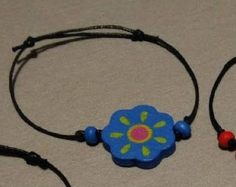 Children's bracelet in waxed cotton and wooden beads