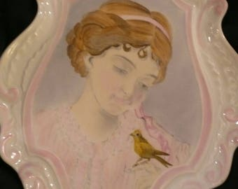 Porcelain hand painted: the girl with bird portrait Shabby gently with a child holding a bird on her finger