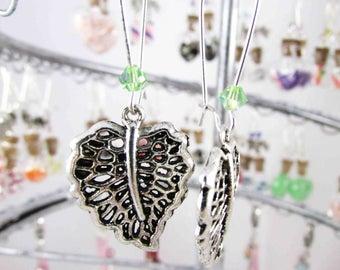 Earrings in silvery metal leaf