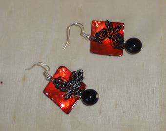 Black butterflies on red square earrings