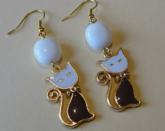White, Brown and gold cat earrings