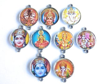 9 cams silicone Indian amulet on 2 cm silver connector backing