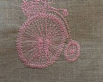 EMBROIDERED BIKE AND HER BASKET