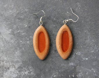 Pierced ears Biscuit tray in light brown and orange resin