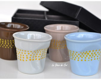 Set of four coffee cups