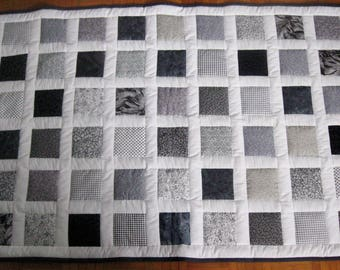 Patchwork black, grey and white checkerboard