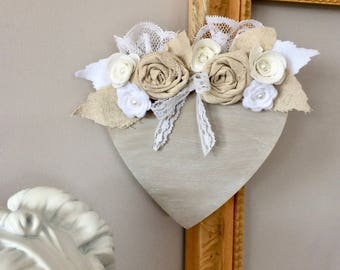 Fretwork wooden heart painted in taupe, decorated with fabric and felt flowers.