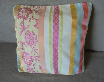 Pillow cover: turquoise, pink, orange, yellow, lime green and ivory.