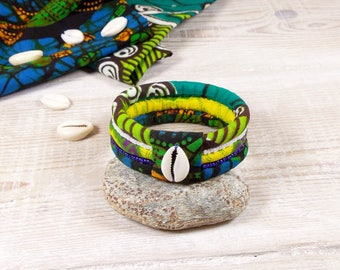 Ethnic bracelet in African Wax fabric with cowrie, beaded, shades of blue green yellow