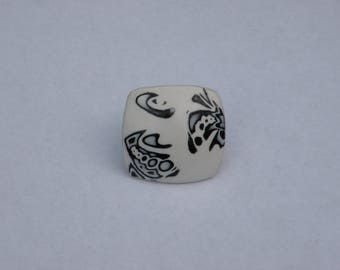 Black and white square ring