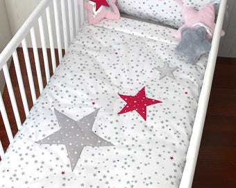 Quilt cover for a baby's cot, white with grey and fuchsia stars