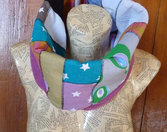 Snood, stars and circles, model made from a blend of fabric scraps