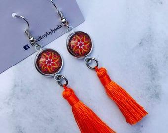Hypo allergenic mandala earrings with neon orange tasseles