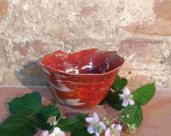 Oriental style orange ceramic bowl