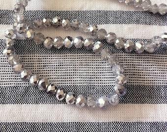 20 swarovski crystal beads 3 x 4 mm silver faceted dark gray