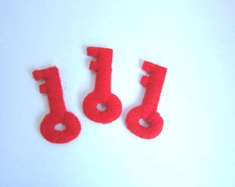 Set of 8 large keys red padded fabric