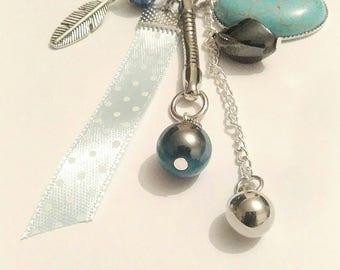Jewel blue bag, pearls and Ribbon.