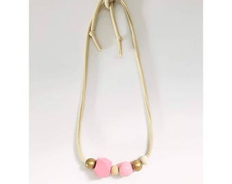 Cream necklace with shades of pink and gold