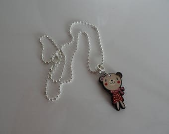 child adorned with a red Teddy bear pendant necklace