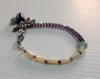 Purple and white bracelet with butterfly