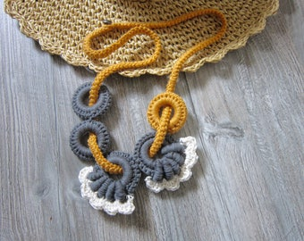 Freeform crochet long necklace, consisting of rings, shapes, cord...