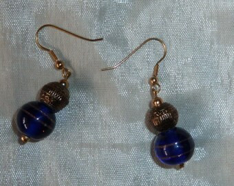 Earrings with blue and gold tone faux Pearl