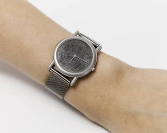 Watch: Meteorite Dial, bathed in rhodium Extensible
