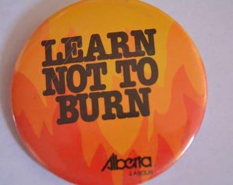 Learn to Burn Alberta Labour button pin