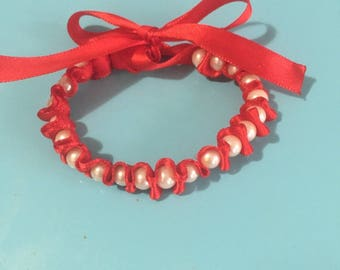 Jewelry beads and Red Ribbon Bracelet