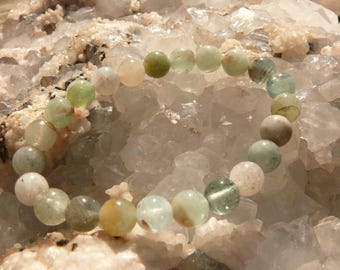 Bracelet round pearls of 8 mm of Aquamarine on elastic thread