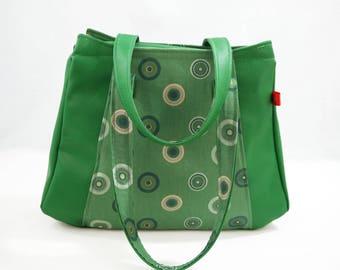 Handbag wears green arms