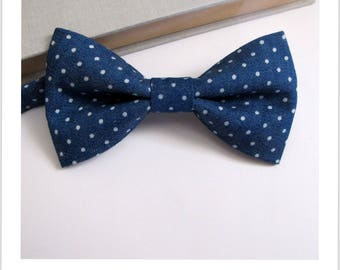 Vintage blue jeans with polka dots bowtie